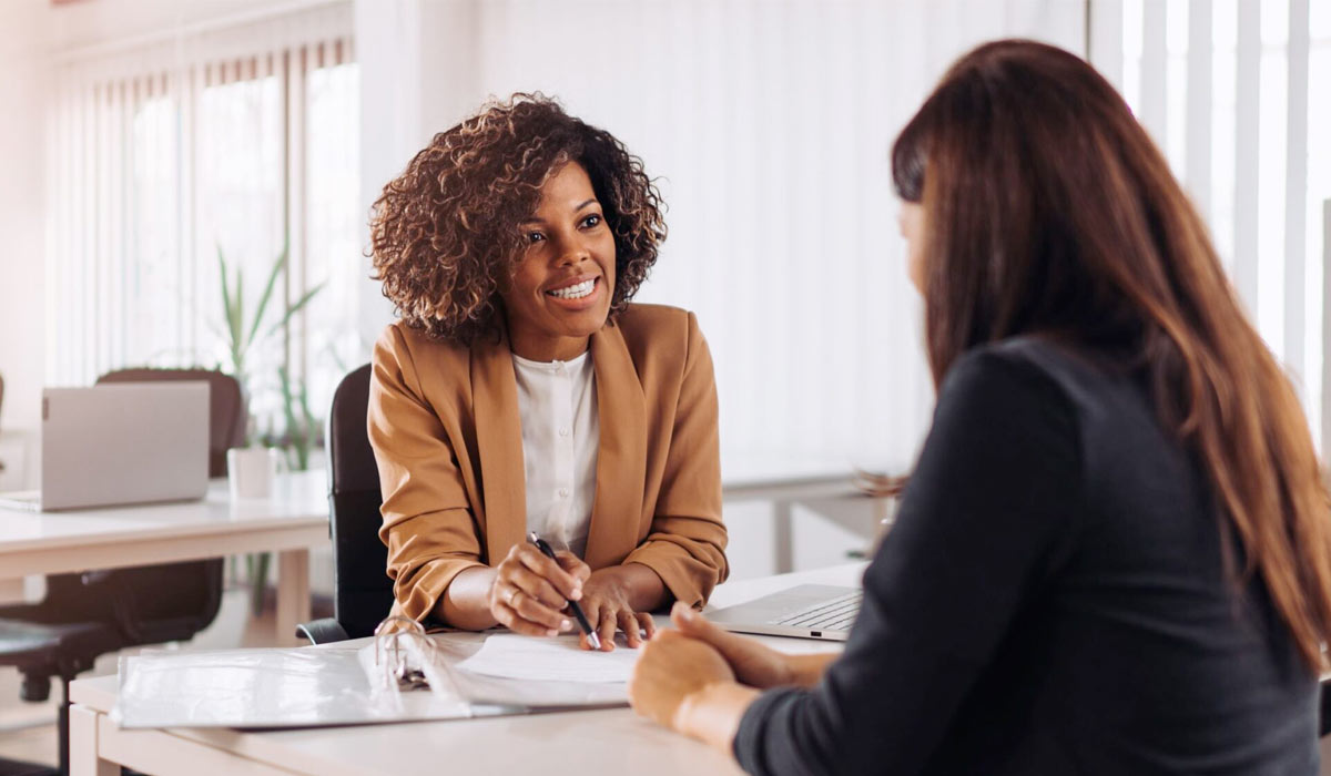 Woman-consulting-with-a-female-financial-manager-at-the-bank
