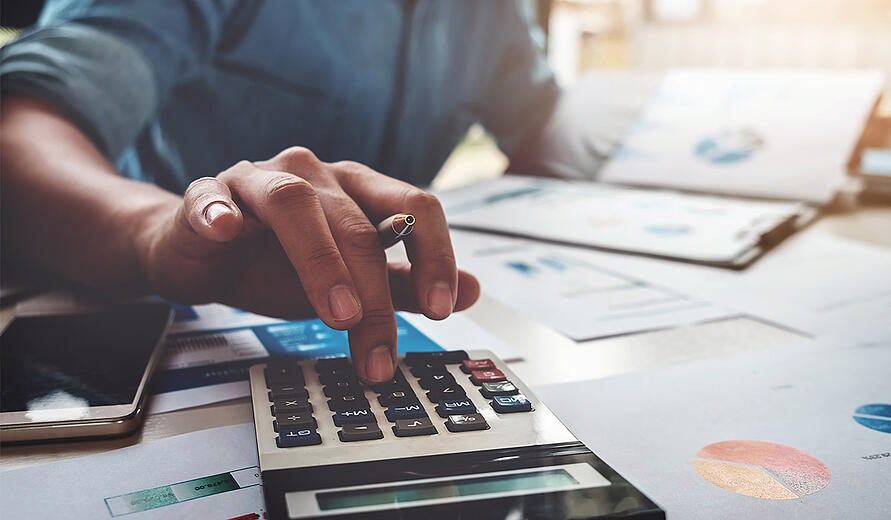 business-man-using-calculator-working-on-financial-documents