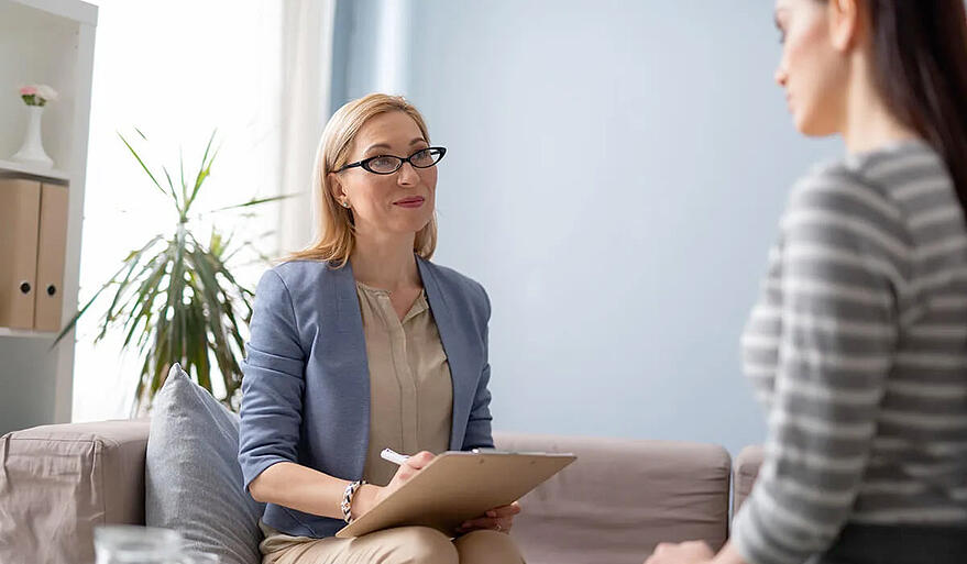 female-divorce-coach-listening-to-woman-attentively
