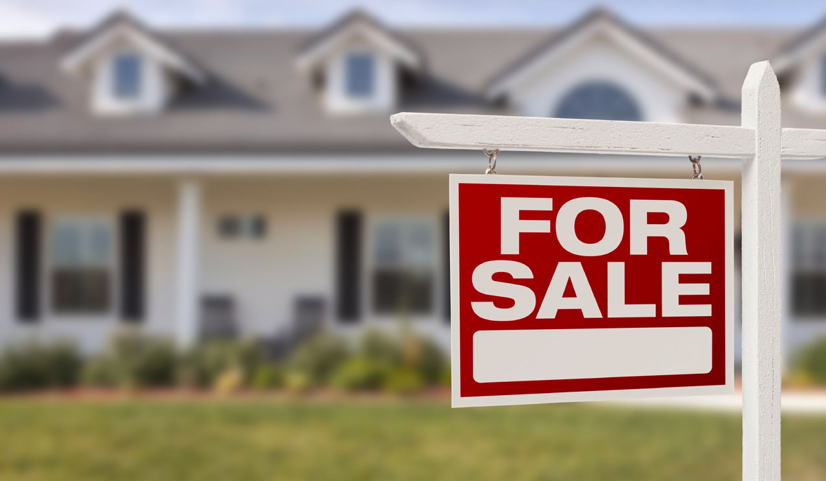 for-sale-sign-in-front-of-home