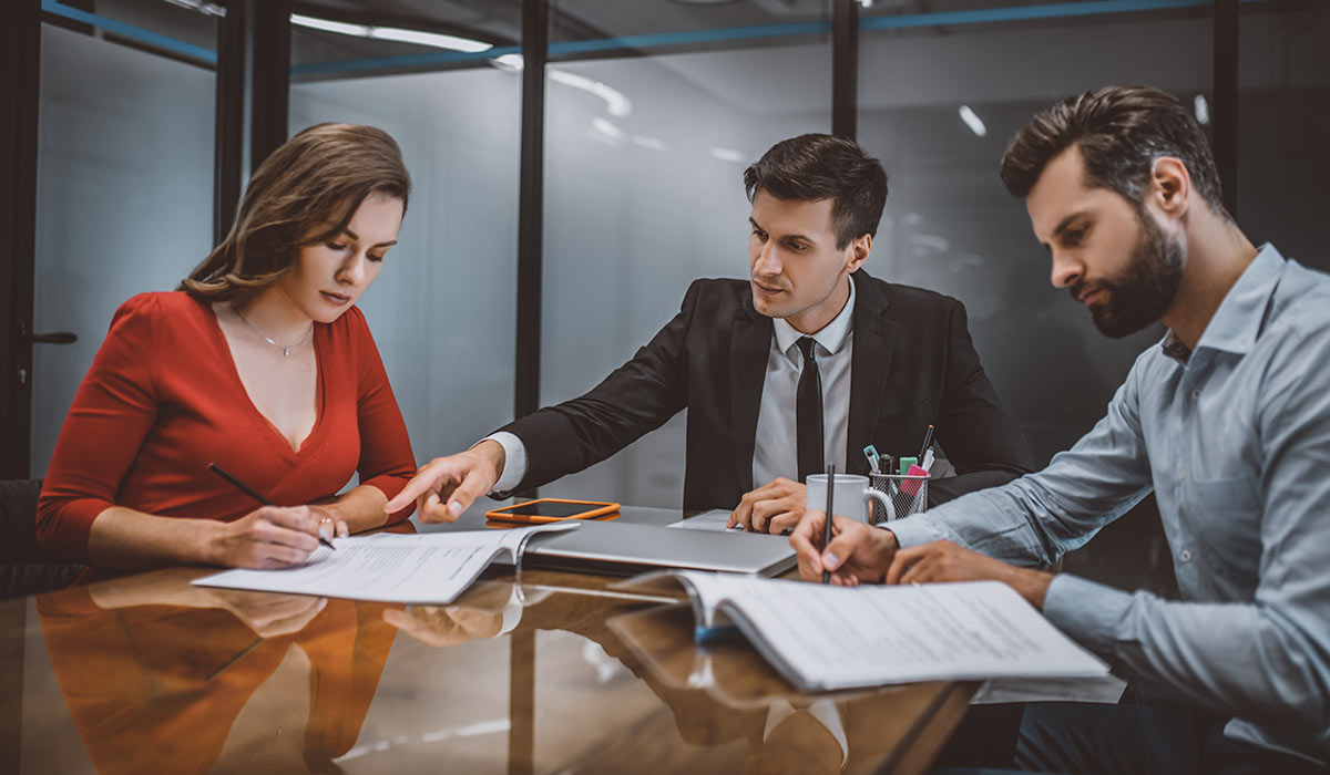 Professional lawyer consulting spouses about legal documents