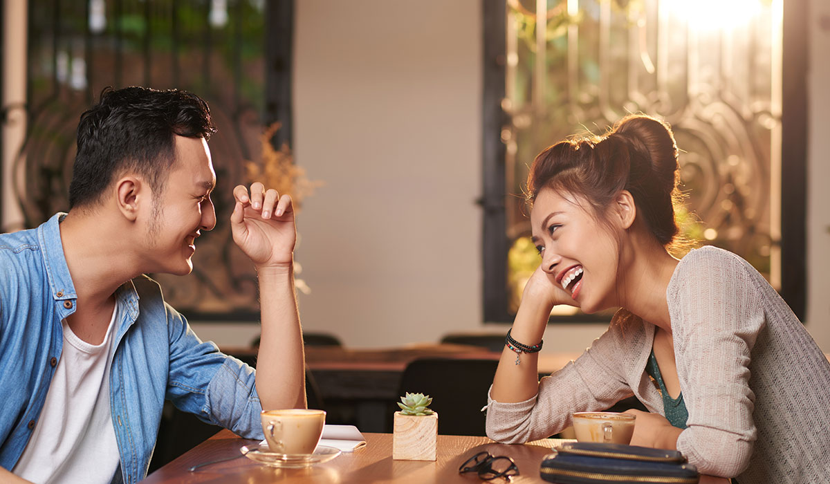 asian couple at a coffee shop