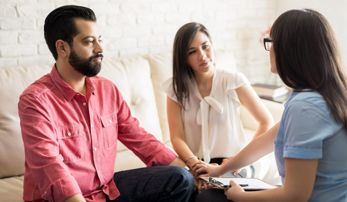 couple talking with divorce mediator