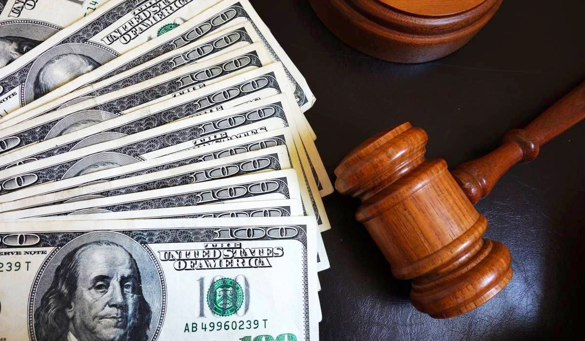 court-gavel-and-hundred-dollar-bills-fanned-out-on-desk
