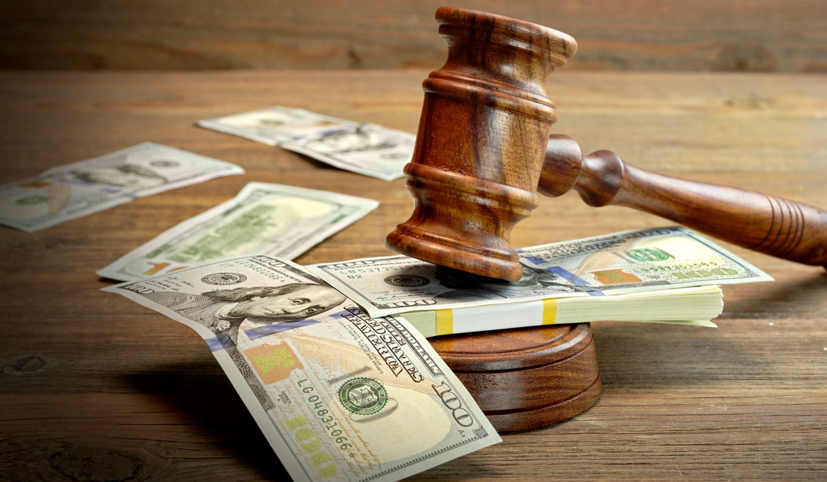 gavel sitting on top of money