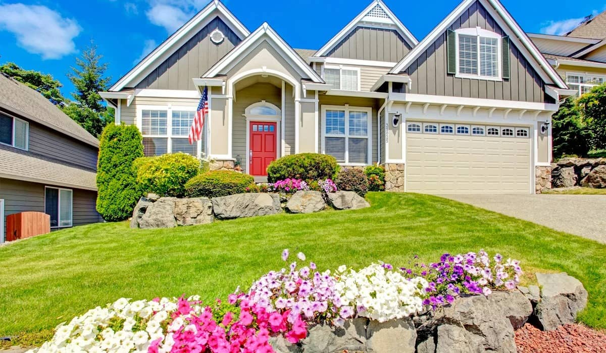 house with beautiful landscape and spring flowers