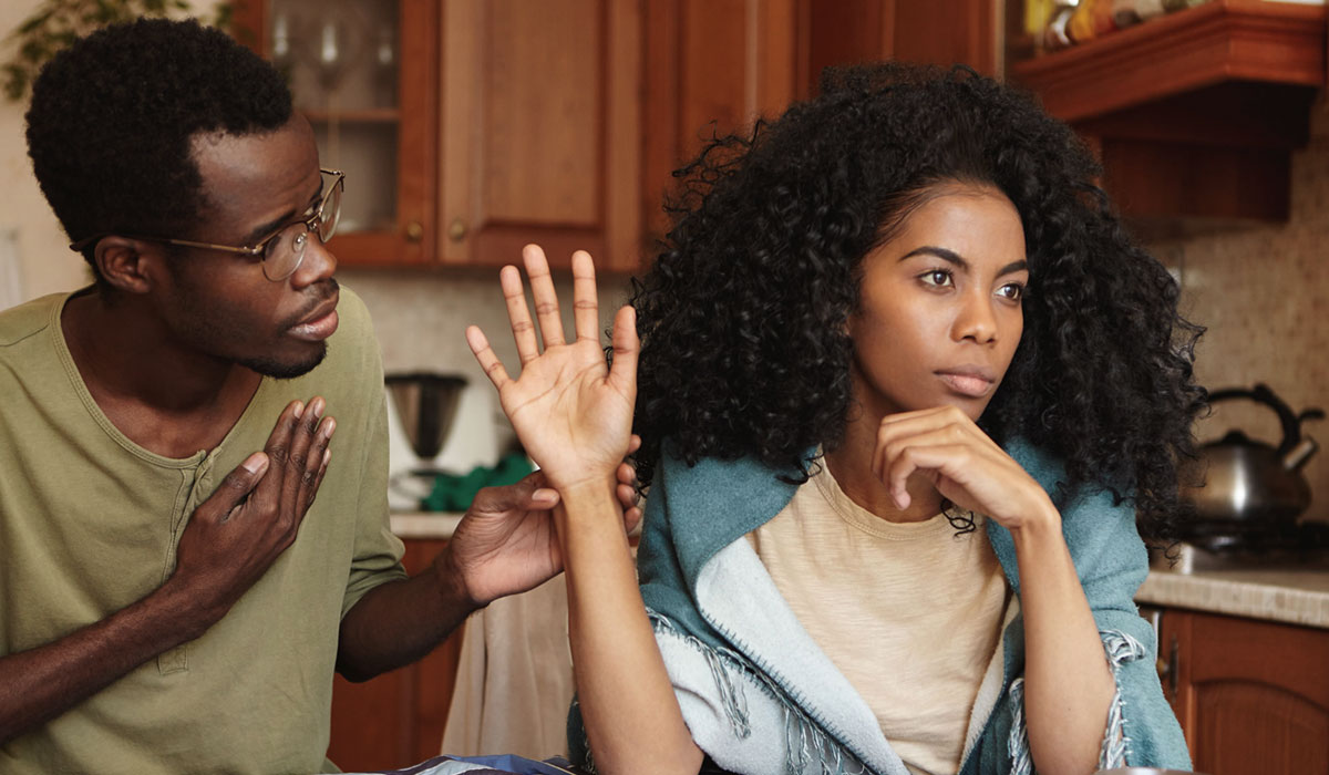 man trying to talk to wife in kitchen but getting rejected