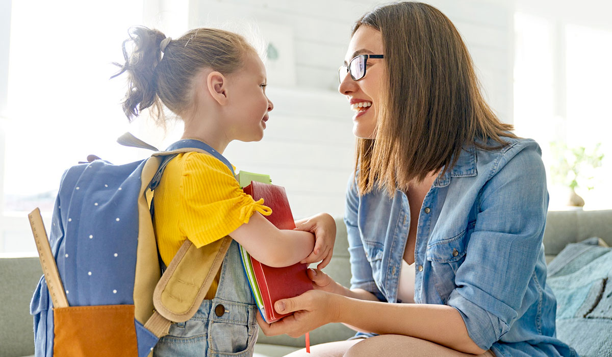 mom getting daughter ready for school