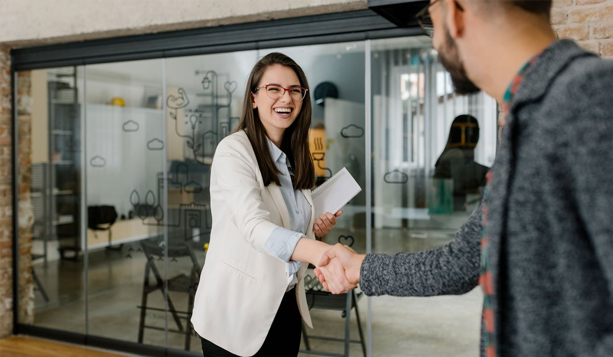 woman shaking hands with human resources manager