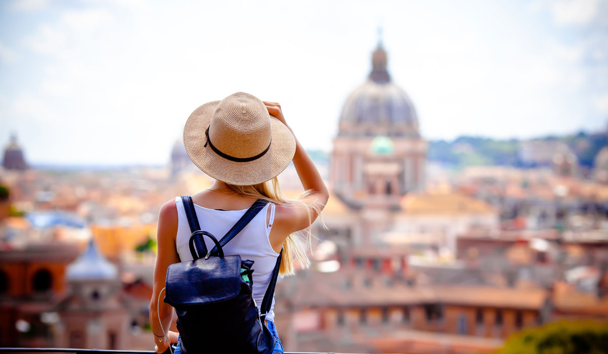 woman traveler looking into scenery in Rome
