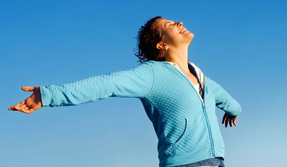 woman with arms outstretched feeling good