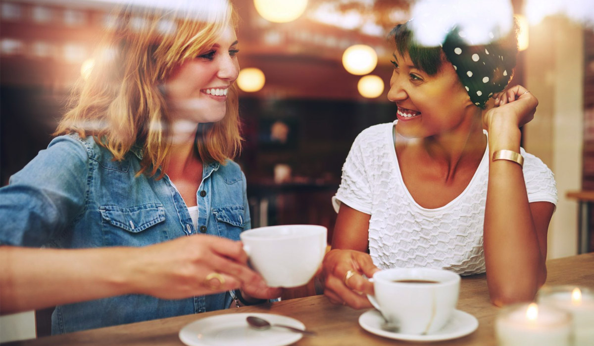 women having coffee together at cafe
