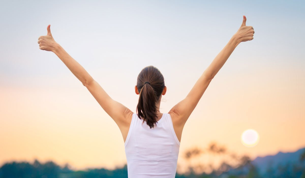 Young woman feeling happy and positive